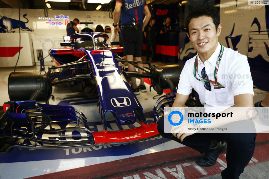 Honda driver Naoki Yamamoto poses for a picture with the Toro Rosso STR13