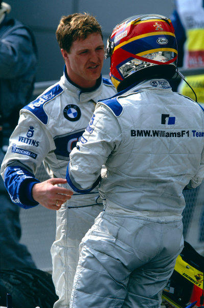 2002 Malaysian Grand PrixSepang, Malaysia. 15th - 17th March 2002.Race winner Ralf Schumacher, BMW Williams FW24, congratulates team mate Juan-Pablo Montoya, on his 2nd place.World Copyright: Clive Rose/LAT Photographicref: 35mm Image A59