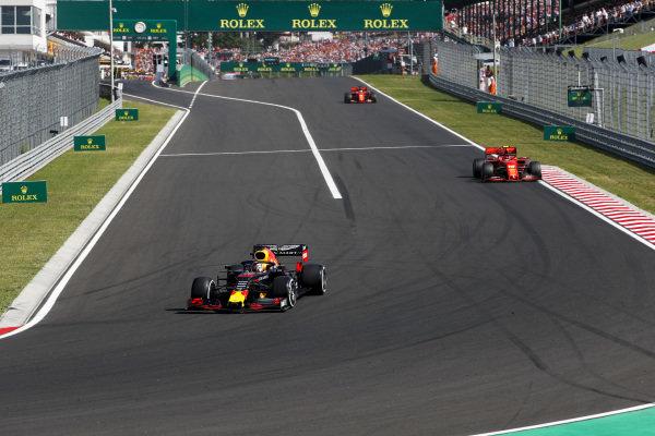 Max Verstappen, Red Bull Racing RB15, rejoins ahead of Charles Leclerc, Ferrari SF90, and Sebastian Vettel, Ferrari SF90
