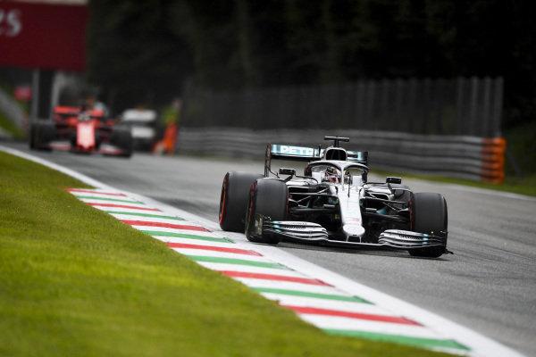 Lewis Hamilton, Mercedes AMG F1 W10 leads Sebastian Vettel, Ferrari SF90