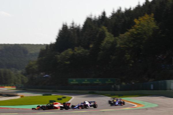 Alexander Albon, Red Bull RB15, leads Pierre Gasly, Toro Rosso STR14 and Daniil Kvyat, Toro Rosso STR14