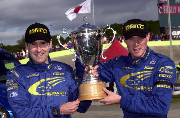 2001 World Rally Championship. Rally of New Zealand. September 20-23, 2001. Auckland, New Zealand. Richard Burns and Robert Reid celebrate with the winners trophy. Photo: Ralph Hardwick/LAT