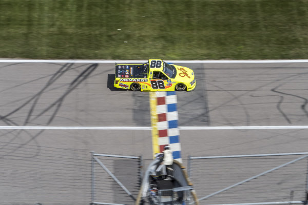#88: Matt Crafton, ThorSport Racing, Ideal Door/Menards Ford F-150 takes the checkered flag to win the race