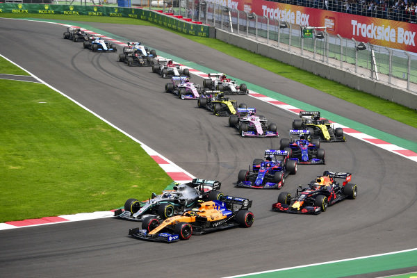 Lando Norris, McLaren MCL34, leads Valtteri Bottas, Mercedes AMG W10, Max Verstappen, Red Bull Racing RB15, Daniil Kvyat, Toro Rosso STR14, Pierre Gasly, Toro Rosso STR14, Daniel Ricciardo, Renault R.S.19, and the remainder of the field at the start