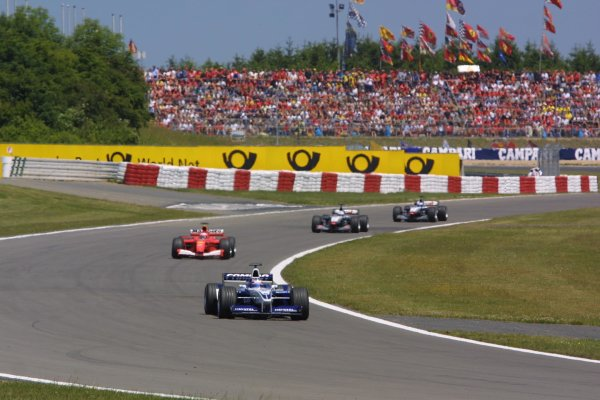 2001 European Grand Prix. RACENurburgring, Germany. 24th June 2001Juan Pablo Montoya, BMW Williams FW23, leads Rubens Barrichello, Ferrari F2001, and the West McLaren Mercedes MP4/16 of David Coulthard and Mika Hakkinen, action.World Copyright - LAT Photographicref: 8 9 MB Digital File Only