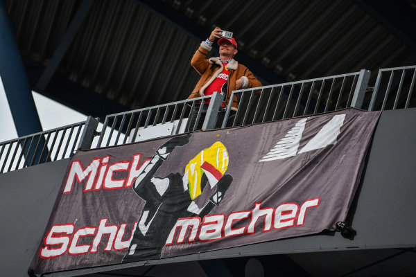 A fan of Mick Schumacher, displays a banner