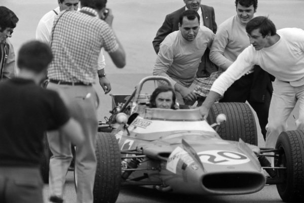 Jackie Stewart, Matra MS80 Ford, celebrates victory by removing his helmet and stopping on the pit straight.