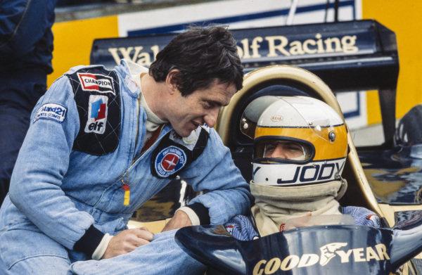 Patrick Depailler talks to teammate Jody Scheckter in the pitlane.