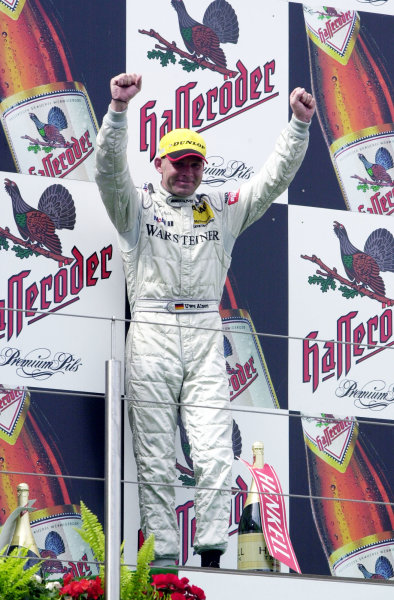 2002 DTM Championship Nurburgring, Germany. 2th - 4th August 2002. Race winner Uwe Alzen (Mercedes CLK-DTM), podium.World Copyright: Andre Irlmeier/LAT Photographic
