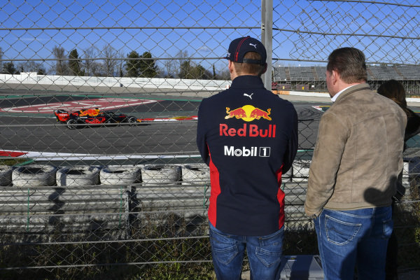 Max Verstappen, Red Bull Racing, and father Jos watch Alexander Albon, Red Bull Racing, trackside