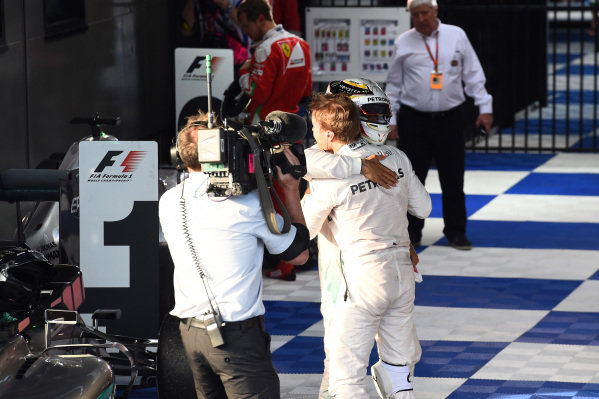 Lewis Hamilton (GBR) Mercedes AMG F1 and Race winner Nico Rosberg (GER) Mercedes AMG F1 celebrate in Parc ferme at Formula One World Championship, Rd1, Australian Grand Prix, Race, Albert Park, Melbourne, Australia, Sunday 20 March 2016.