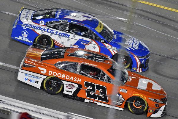 #23: Bubba Wallace, 23XI Racing, Toyota Camry Door Dash and #5: Kyle Larson, Hendrick Motorsports, Chevrolet Camaro HendrickCars.com