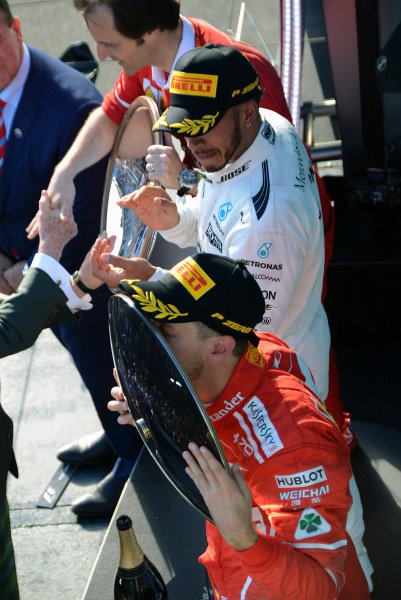 Race winner Sebastian Vettel (GER) Ferrari celebrates on the podium with the trophy at Formula One World Championship, Rd1, Australian Grand Prix, Race, Albert Park, Melbourne, Australia, Sunday 26 March 2017.