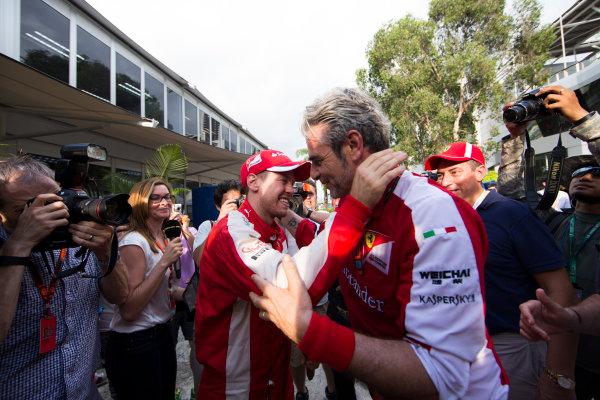 Sepang International Circuit, Sepang, Kuala Lumpur, Malaysia. Sunday 29 March 2015. Sebastian Vettel, Ferrari, celebrates his win with Mauricio Arrivabene, Team Principal, Ferrari. World Copyright: Lorenzo Bellanca/LAT Photographic. ref: Digital Image _00P1931