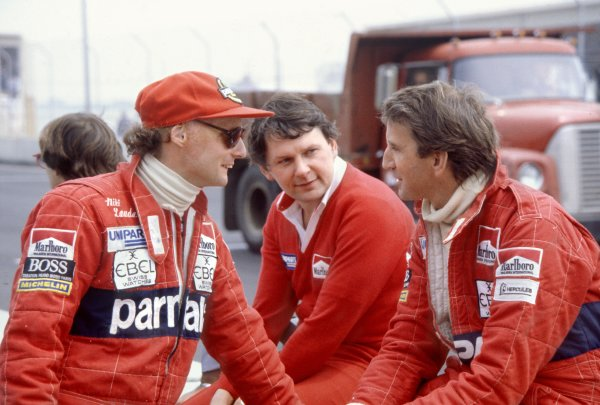 1982 Detroit Grand Prix. Detroit, United States. 6 June 1982. Niki Lauda, McLaren MP4/1B-Ford, retired, John Barnard and John Watson, McLaren MP4/1B-Ford, 1st position, portrait. World Copyright: LAT Photographic Ref: 35mm transparency 82USA17