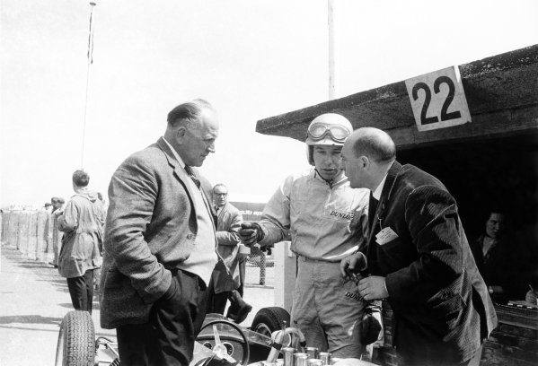 1962 Dutch Grand Prix Zandvoort, Holland. 18-20 May 1962 Reg Parnell and John Surtees in conversation with an engineer. Portrait World Copyright: LAT PhotographicRef: Autosport b&w print