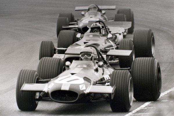 1969 Dutch Grand Prix.Zandvoort, Holland. 21 June 1969.Jack Brabham, Brabham BT26-Ford, 6th position, leads Chris Amon, Ferrari 312, 3rd position, and Jacky Ickx, Brabham BT26-Ford, 5th position, action.World Copyright: LAT PhotographicRef: L69/631 #30A