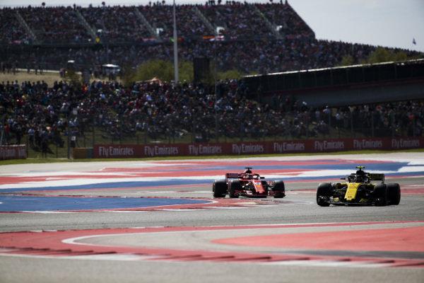 Carlos Sainz Jr., Renault Sport F1 Team R.S. 18, leads Sebastian Vettel, Ferrari SF71H