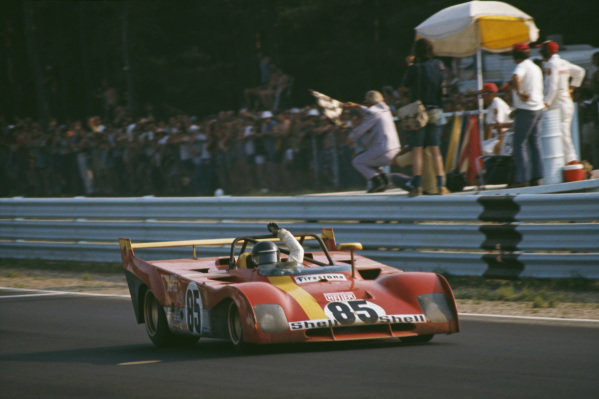 Jacky Ickx celebrates as he takes the chequered flag for victory in his SEFAC Ferrari, Ferrari 312 PB.