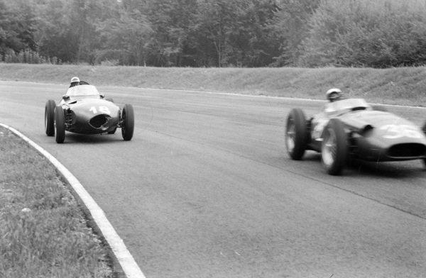 Stirling Moss, Maserati 250F, leads Harry Schell, Vanwall.