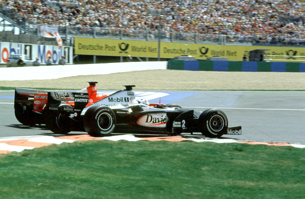 2000 French Grand Prix.Magny-Cours, France. 30/6-2/7 2000.David Coulthard (McLaren MP4/15 Mercedes) overtakes Michael Schumacher (Ferrari F1-2000) for the lead at the Hairpin.World Copyright - LAT PhotographicFormat: 35mm transparency
