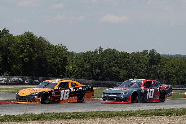#18: Daniel Hemric, Joe Gibbs Racing, Toyota Supra Poppy Bank and #10: Jeb Burton, Kaulig Racing, Chevrolet Camaro Rocky Boots