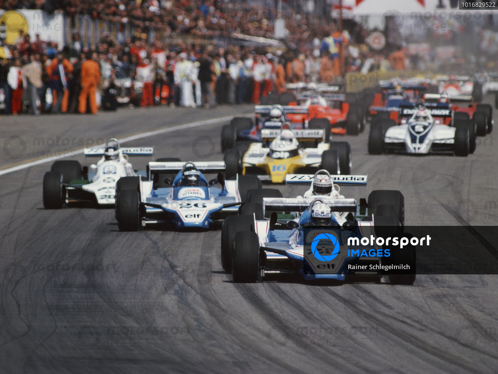 Didier Pironi, Ligier JS11/15 Ford, leads from Alan Jones, Williams FW07B Ford, Jacques Laffite, Ligier JS11/15 Ford, and Carlos Reutemann, Williams FW07B Ford, at the start of the race.