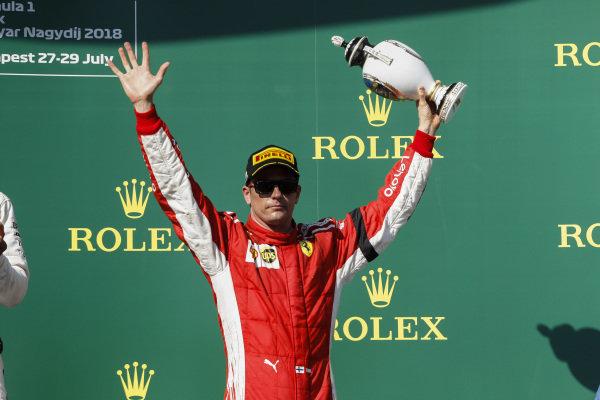 Kimi Raikkonen, Ferrari celebrates on the podium with champagne.