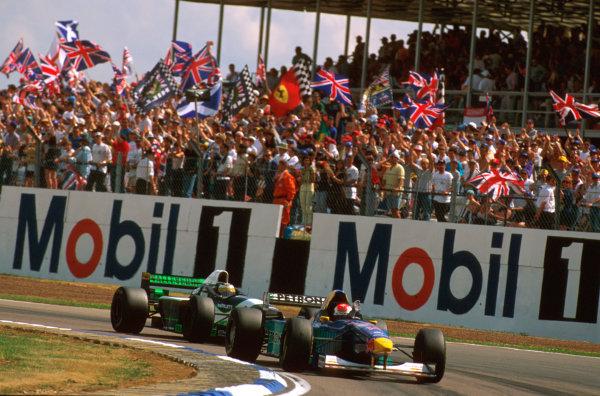 Silverstone, England.12-14 July 1996.Johnny Herbert (Sauber C15 Ford) followed by Giancarlo Fisichella (Minardi M195B Ford).Ref-96 GB 20.World Copyright - LAT Photographic