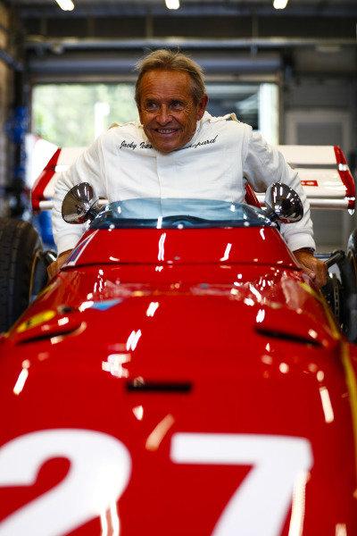 Belgian racing legend Jacky Ickx demonstrates a Ferrari 312B.