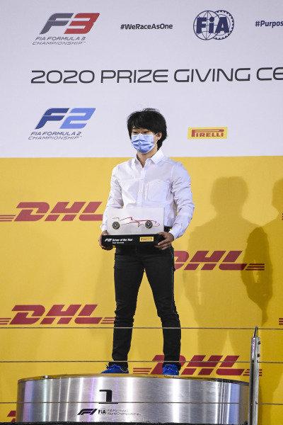 F2 driver of the year Yuki Tsunoda (JPN, CARLIN) celebrates on the podium with the trophy