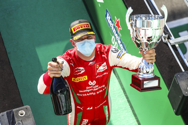 Race Winner Mick Schumacher (DEU, PREMA RACING) celebrates on the podium with the champagne and the trophy