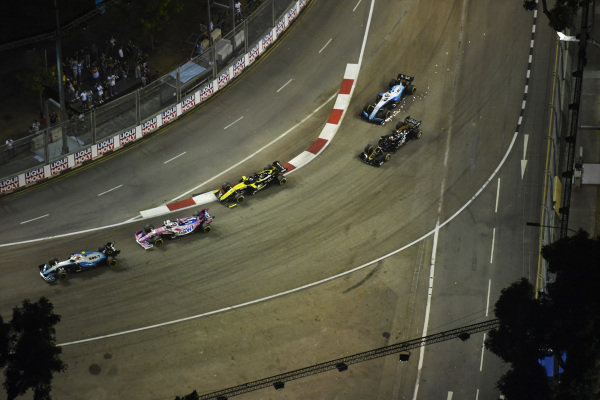Robert Kubica, Williams FW42, leads Sergio Perez, Racing Point RP19, Daniel Ricciardo, Renault R.S.19, Romain Grosjean, Haas VF-19, and George Russell, Williams Racing FW42