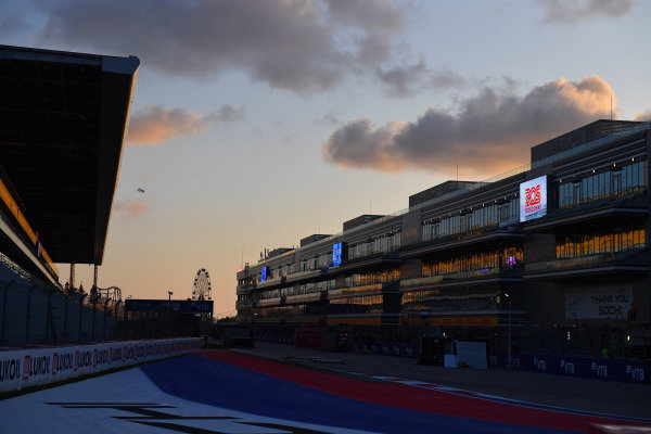 The sun sets on the circuit after the days racing