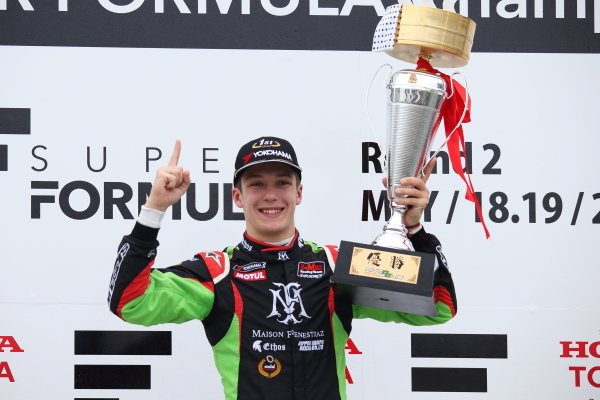 Race Winner Sacha Fenestraz, B-Max Racing with motopark F3 celebrates on the podium with the trophy
