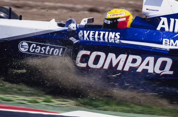 Ralf Schumacher, Williams FW23 BMW, goes for a trip across the gravel.