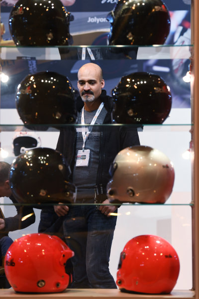 Autosport International Exhibition. National Exhibition Centre, Birmingham, UK. Sunday 15 January 2017. A visitor views a display of helmets. World Copyright: Sam Bagnall/LAT Images Ref: DSC_5627