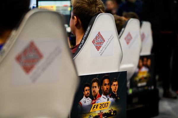 Autosport International Exhibition. National Exhibition Centre, Birmingham, UK. Saturday 13th January, 2018. Fans race simulators on the Bahrain stand.World Copyright: Joe Portlock/LAT Images Ref: _U9I0909