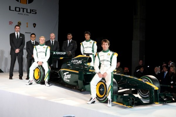 The new Lotus T127 with (L to R): Keith Saunt (GBR) Chief Operating Officer, Riad Asmat (MAL) CEO Lotus Racing, Mike Gascoyne (GBR) Lotus F1 Racing Chief Technical Officer, Tony Fernandes (MAL), Heikki Kovalainen (FIN), Fairuz Fauzy (MAL) Lotus F1 Racing test driver and Jarno Trulli (ITA) Lotus.