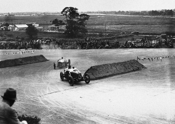 Brooklands, Great Britain.7 August 1926. George Eyston (Aston-Martin GP) leads Robert Senechal/Louis Wagner (Delage 15S8). Senechal/Wagner finished in 1st position, action. Ref:Autocar Glass Plate A6526. World Copyright: LAT Photographic