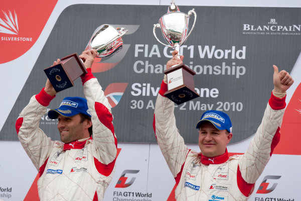 Silverstone, England. 30th April - 2nd May 2010.Darren Turner / Tomas Enge, (Young Driver AMR, Aston Martin DB9) celebrate their victory on the podium. World Copyright: Alastair Staley/LAT PhotographicRef: _P9O2629 jpg