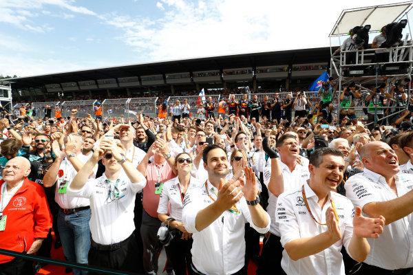 Red Bull Ring, Spielberg, Austria. Sunday 9 July 2017. The Mercedes team cheer for Valtteri Bottas, Mercedes AMG, 1st Position, on the podium. World Copyright: Steven Tee/LAT Images ref: Digital Image _O3I8675
