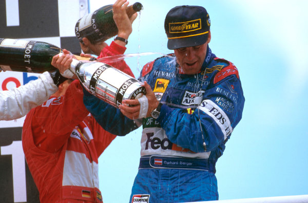 Hockenheim, Germany.25-27 July 1997.Gerhard Berger (Benetton Renault) celebrates 1st position on the podium whilst getting a spraying.Ref-97 GER 10.World Copyright - LAT Photographic