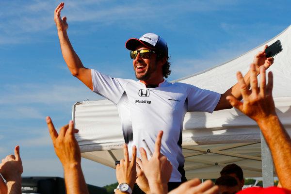 Hungaroring, Budapest, Hungary. Thursday 21 July 2016. Fernando Alonso, McLaren with his fans. World Copyright: Andrew Hone/LAT Photographic ref: Digital Image _ONY0324