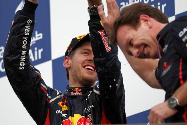 Bahrain International Circuit, Sakhir, Bahrain22nd April 2012Sebastian Vettel, Red Bull Racing, 1st position, soaks Christian Horner, Team Principal, Red Bull Racing. World Copyright: Andy Hone/LAT Photographicref: Digital Image HONY8720