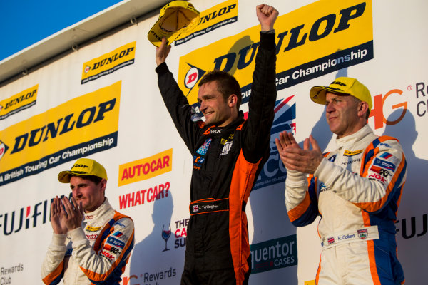 2015 British Touring Car Championship, Silverstone, Northamptonshire, England. 26th - 27th September 2015. Sam Tordoff (GBR) WSR BMW 125i M Sport, 3rd position, Colin Turkington (GBR) Team BMR Volkswagen Passat CC, 1st position, and Rob Collard (GBR) WSR BMW 125i M Sport, 2nd position, on the podium. World Copyright: Zak Mauger/LAT Photographic. ref: Digital Image _L0U4848