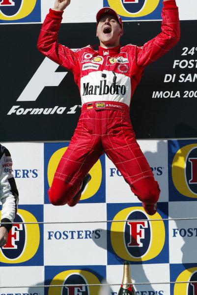 2004 San Marino Grand Prix - Sunday Race,2004 San Marino Grand Prix Imola, Italy. 25th April 2004.The Schumacher leap. Podium. World Copyright: Steve Etherington/LAT Photographic ref: Digital Image Only