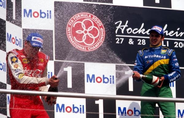 On the podium second place finisher Justin Wilson (GBR)  (left) and first time race winner Antonio Pizzonia (BRA)  battle it out with the celebratory champagne.