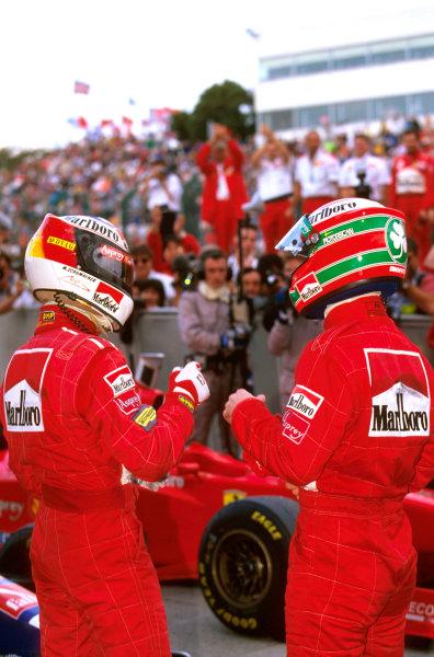 Suzuka, Japan.10-12 October 1997.Michael Schumacher and Eddie Irvine celebrate a 1-3 finishfor Ferrari in parc ferme.Ref-97 JAP 01.World Copyright - LAT Photographic