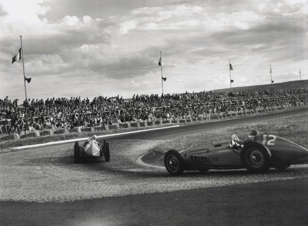 """1949 French Grand Prix. Reims, France. 17 July 1949. Louis Chiron, Lago-Talbot T26C, 1st position, leads """"Pierre Levegh"""", Lago-Talbot T26C, retired, action. World Copyright: LAT Photographic Ref: C24991"""